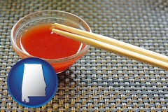 alabama map icon and chopsticks and red hot sauce in a Chinese restaurant