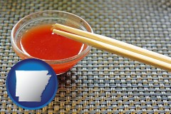 arkansas map icon and chopsticks and red hot sauce in a Chinese restaurant