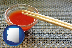 arizona chopsticks and red hot sauce in a Chinese restaurant