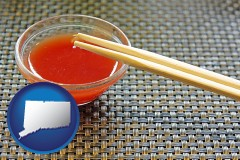 connecticut map icon and chopsticks and red hot sauce in a Chinese restaurant