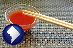 washington-dc map icon and chopsticks and red hot sauce in a Chinese restaurant