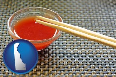 delaware chopsticks and red hot sauce in a Chinese restaurant