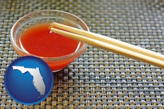florida map icon and chopsticks and red hot sauce in a Chinese restaurant