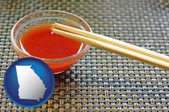 georgia map icon and chopsticks and red hot sauce in a Chinese restaurant