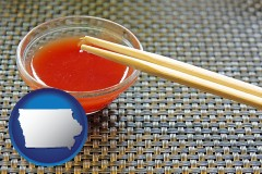 iowa chopsticks and red hot sauce in a Chinese restaurant