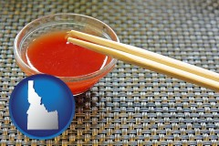 idaho chopsticks and red hot sauce in a Chinese restaurant