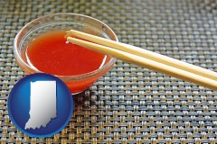 indiana map icon and chopsticks and red hot sauce in a Chinese restaurant
