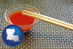 louisiana map icon and chopsticks and red hot sauce in a Chinese restaurant