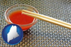 maine map icon and chopsticks and red hot sauce in a Chinese restaurant