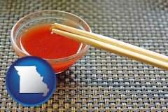 missouri chopsticks and red hot sauce in a Chinese restaurant
