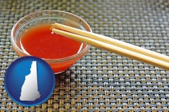 new-hampshire chopsticks and red hot sauce in a Chinese restaurant