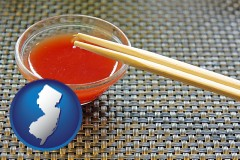 new-jersey chopsticks and red hot sauce in a Chinese restaurant