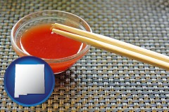 new-mexico map icon and chopsticks and red hot sauce in a Chinese restaurant