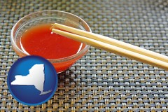 new-york map icon and chopsticks and red hot sauce in a Chinese restaurant