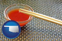 oklahoma chopsticks and red hot sauce in a Chinese restaurant
