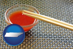 tennessee chopsticks and red hot sauce in a Chinese restaurant