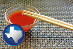 texas map icon and chopsticks and red hot sauce in a Chinese restaurant
