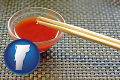 vermont map icon and chopsticks and red hot sauce in a Chinese restaurant