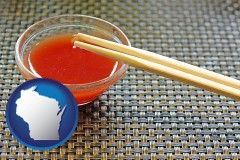 wisconsin chopsticks and red hot sauce in a Chinese restaurant