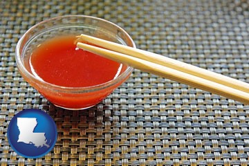 chopsticks and red hot sauce in a Chinese restaurant - with Louisiana icon