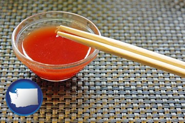 chopsticks and red hot sauce in a Chinese restaurant - with Washington icon