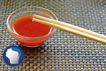 chopsticks and red hot sauce in a Chinese restaurant - with Wisconsin icon